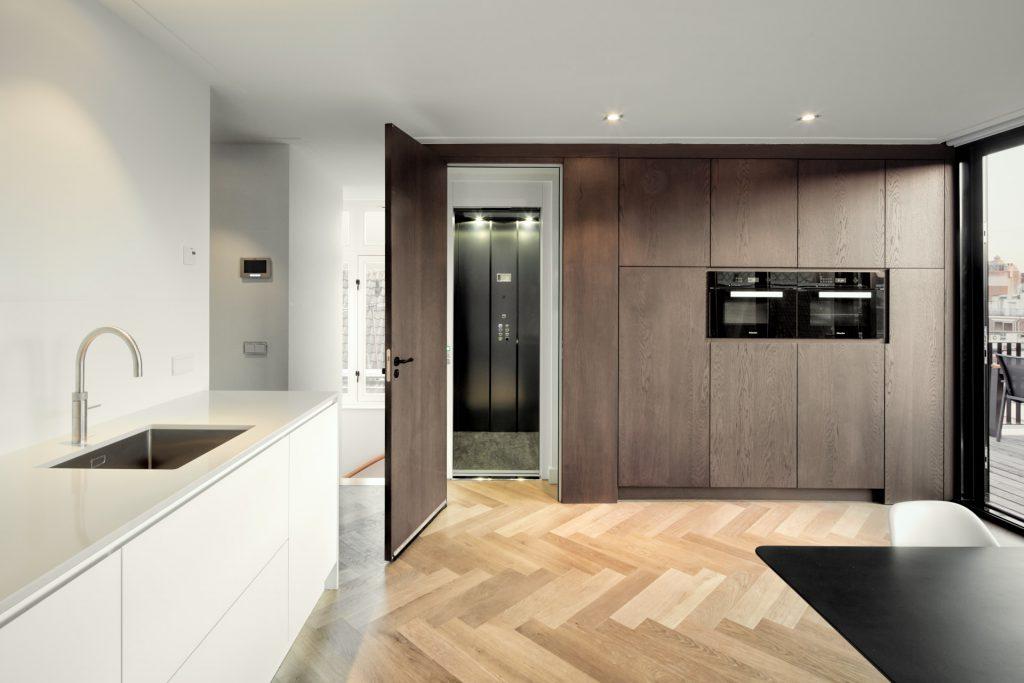 Compleet ontwerp voor een luxe penthouse met eigen lift in het centrum van Amsterdam.